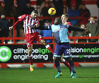 captain Seamus Conneely of Accrington Stanley beats Adebayo Akinfenwa of Wycombe Wanderers to the ball <br /> during the Sky Bet League 2 match between Accrington Stanley and Wycombe Wanderers at the wham stadium, Accrington, England on 28 February 2017. Photo by Tony  KIPAX.