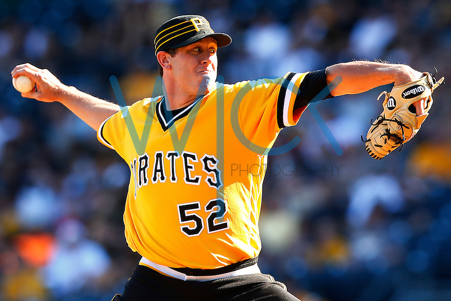 Rob Scahill #52 of the Pittsburgh Pirates pitches against the Milwaukee Brewers during the game at PNC Park in Pittsburgh, Pennsylvania on April 17, 2016. (Photo by Jared Wickerham / DKPS)