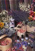 Rose petals, lavender, dried flowers, essential oils, oil burner, baskets, ingredients for making scented potpourri & aromatherapy products