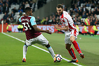 /Edimilson Fernandes of West Ham United and Ramadan Sobhi of Stoke City during West Ham United vs Stoke City, Premier League Football at The London Stadium on 16th April 2018