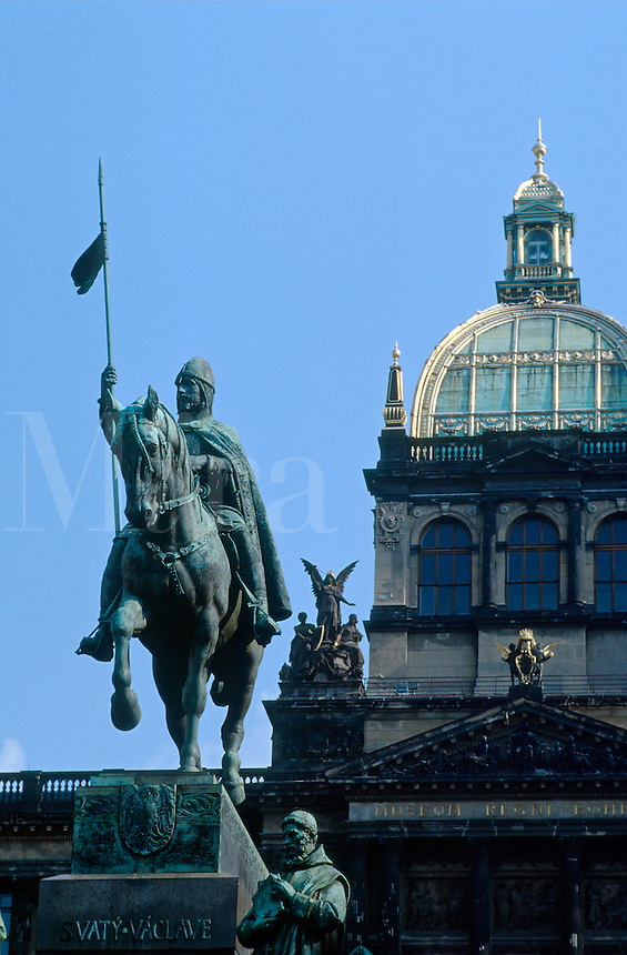 St. Wenceslas Memorial, a popular rendezvous point for visitors and residents, was erected in 1912. Sculptor - J. V. Myslbek. Wenceslas Square. National Museum in background. In Czech language Wenceslas is Vaclav. Nove Mesto. Vaclavske namesti. 103093 35.