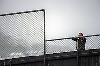 A fan watches over the fence during the Oceania Football Championship final (first leg) football match between Team Wellington and Lautoka FC at David Farrington Park in Wellington, New Zealand on Sunday, 13 May 2018. Photo: Dave Lintott / lintottphoto.co.nz