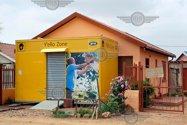 A Y'ello Zone phone shop attached to a house in the Mamelodi township.