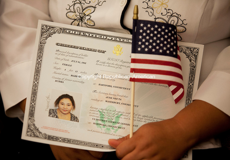 HARTFORD, CT-11 July 2014-071114BF04- Native Karen and former refugee June Nee Ta, 32, holds her naturalization document during a naturalization ceremony in U. S. District Court in Hartford Friday. Four former refugees from Burma have resided in Waterbury for seven years and became United States citizens Friday. Bob Falcetti Republican-American