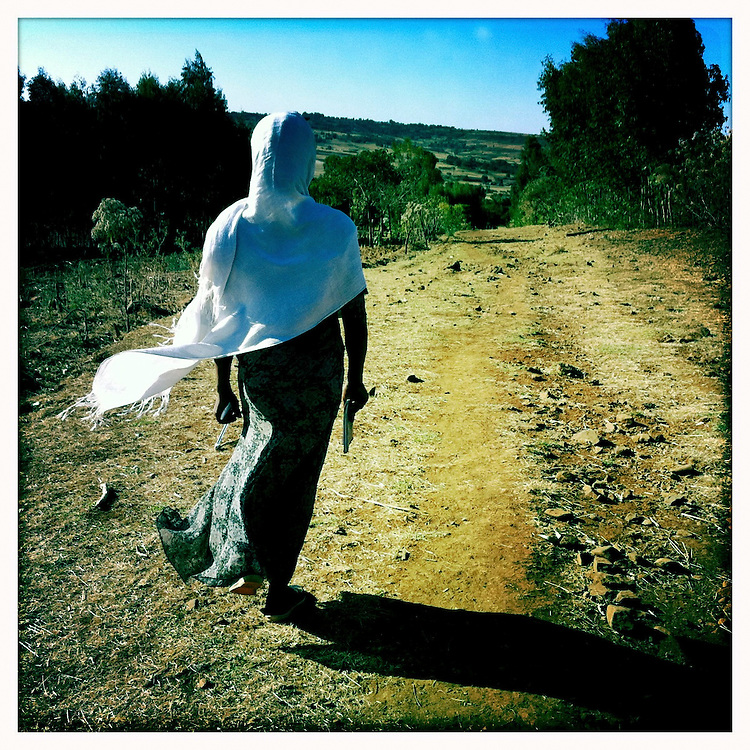 World Vision community organizer walking in Northern Ethiopia.