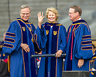 May 17, 2015; Shirley Welsh Ryan waves to the crowd after University of Notre Dame President Rev. John Jenkins, C.S.C. (left) and Notre Dame Board of Trustees Chairman Richard Notebaert awarded her an honorary doctorate at the 2015 Commencement ceremony. (Photo by Barbara Johnston/University of Notre Dame)