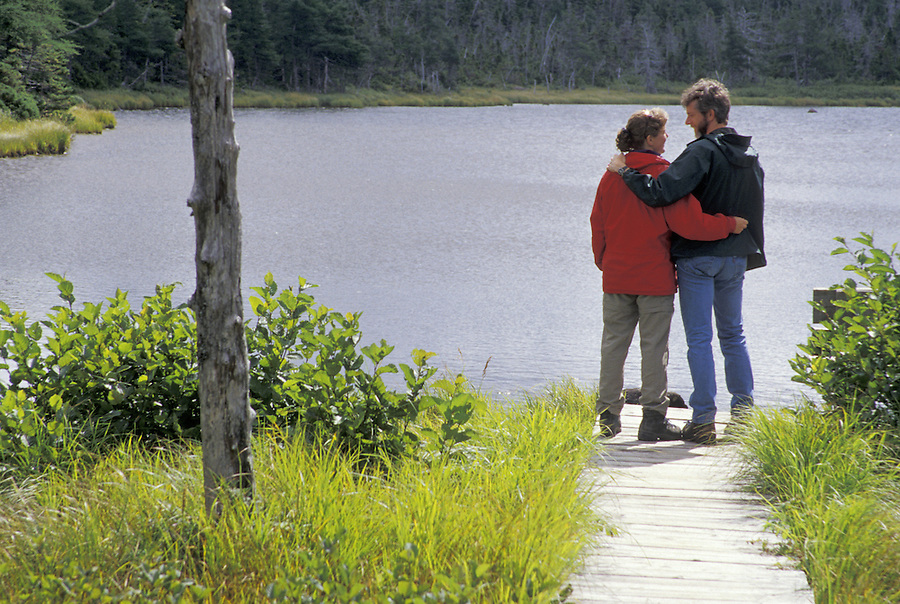 Couple at lake, Benjies Lake Trail, Cape Breton National Park, Nova Scotia, Canada