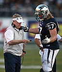Nevada Head Coach Brian Polian talks with Connor Talbott during the second half of an NCAA college football game against UNLV in Reno, Nev., on Saturday, Oct. 26, 2013.<br /> Photo by Cathleen Allison