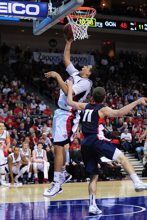 March 5, 2012; Las Vegas, NV, USA; Saint Mary's Gaels forward Brad Waldow (left) shoots the ball against Gonzaga Bulldogs guard David Stockton (11) during the WCC Basketball Championships at Orleans Arena.