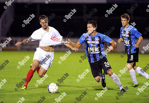 2013-09-11 / Voetbal / seizoen 2013-2014 / Rupel-Boom - Londerzeel / Koen Carlier met Tino Pellegriti (r. Rupel-Boom)<br /><br />Foto: Mpics.be