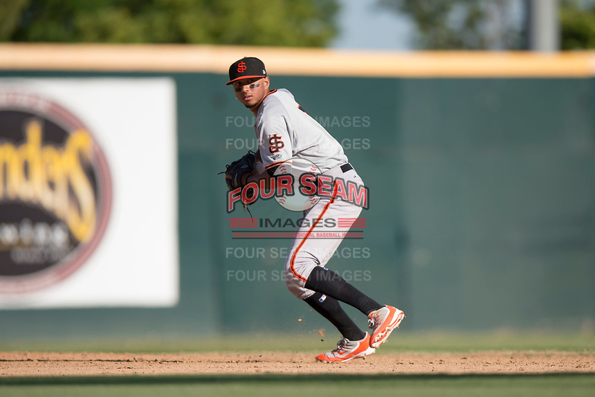 San Jose Giants shortstop Brandon Van Horn (9) prepares to make a throw to first base during a California League game against the Modesto Nuts at John Thurman Field on May 9, 2018 in Modesto, California. San Jose defeated Modesto 9-5. (Zachary Lucy/Four Seam Images)