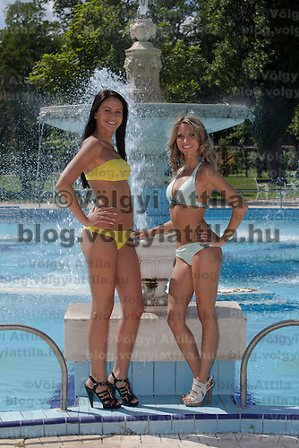 Diana Ficsor (L) and Andrea Makk (R) pose for photographers during the Miss Bikini Hungary beauty contest held in Budapest, Hungary on August 29, 2010. ATTILA VOLGYI