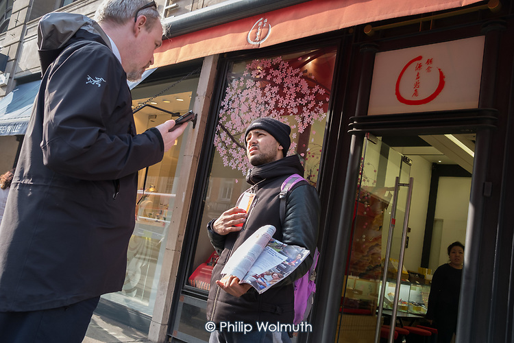 West End Ambassador employed by the Heart of London Business Alliance confronts a Big Issue seller in Piccadilly.
