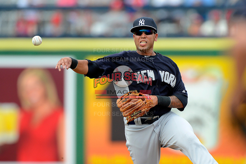 New York Yankees shortstop Cito Culver #90 throws to first after fielding a grounder during a Spring Training game against the Philadelphia Phillies at Bright House Field on February 26, 2013 in Clearwater, Florida.  Philadelphia defeated New York 4-3.  (Mike Janes/Four Seam Images)