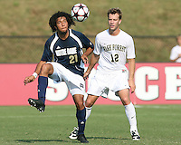 04 September 2009: Justin Morrow #21 of the University of Notre Dame pulls in a high ball in front of Zack Cchilawski #12 of Wake Forest University during an Adidas Soccer Classic match at the University of Indiana in Bloomington, In. The game ended in a 1-1 tie..
