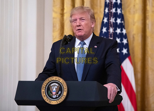 """United States President Donald J. Trump makes remarks on """"America's Environmental Leadership"""" in the East Room of the White House in Washington, DC on Monday, July 8, 2019.<br /> CAP/MPI/RS<br /> ©RS/MPI/Capital Pictures"""