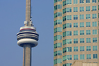 Office building and the CN Tower....The CN Tower, located in Toronto, Ontario, Canada, is the world's tallest freestanding structure on land, standing 553.33 meters (1,815 ft 5 in) tall. It is considered the signature icon of the city, attracting more than two million international visitors annually....Photo : Pierre Roussel - Images Distribution