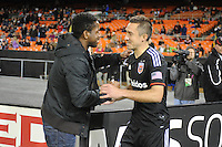 Washington, D.C.- March 29, 2014. D.C. United former player Clyde Simms greeting Bobby Boswell and thanking him for his support during his kidney disease tribulations.  D.C. United defeated the New England Revolution 2-0 during a Major League Soccer Match for the 2014 season at RFK Stadium.