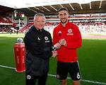 Chris Wilder manager of Sheffield Utd presents Chris Basham of Sheffield Utd with a token to mark his 150th first team start during the Championship match at Bramall Lane Stadium, Sheffield. Picture date 16th September 2017. Picture credit should read: Simon Bellis/Sportimage