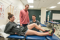 NWA Democrat-Gazette/ANTHONY REYES • @NWATONYR<br /> Scott Van Camp (right) demonstrates how to measure range of motion on Gracie Frizzell as Kyle Roliard, all University of Arkansas for Medical Sciences physical therapy students, looks on Thursday, Dec. 10, 2015 at the school in Fayetteville. The school is finishing its first semester in Fayetteville.