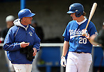 Western Nevada College's Head Coach DJ Whittemore talks with Kody Reynolds during a game against the College of Southern Idaho at John L. Harvey Field, in Carson City, Nev., on Friday, March 28, 2014. <br />