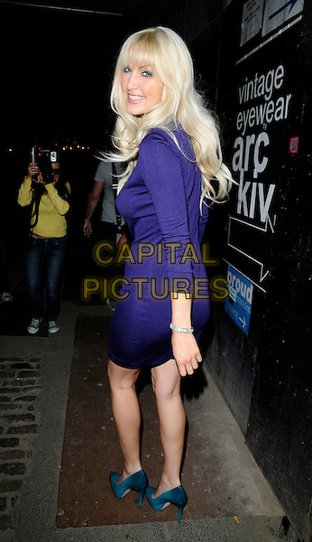EMMA NOBLE.The ZooQoo.com launch party, Proud Camden Galleries, Chalk Farm Road, London, England..August 27th, 2008.full length blue purple dress turquoise shoes looking over shoulder teal.CAP/CAN.©Can Nguyen/Capital Pictures.