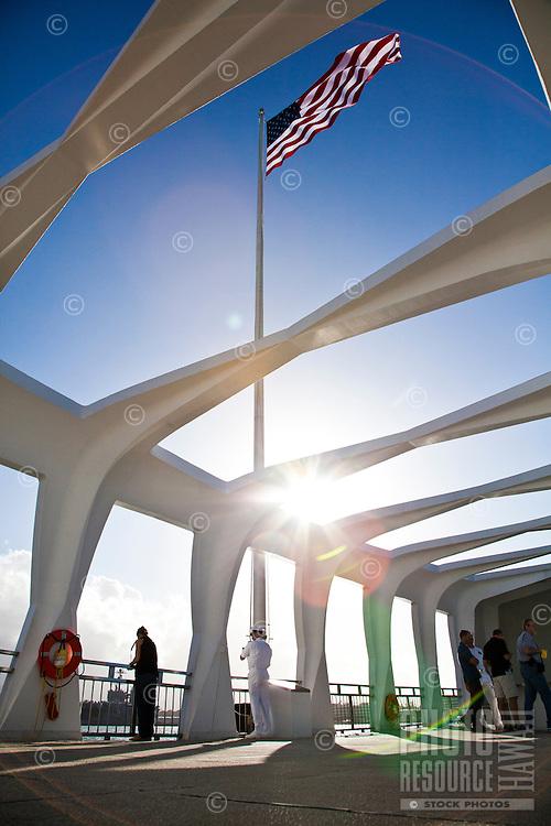 Visitors and military personnel at the Arizona Memorial at Pearl Harbor, Oahu
