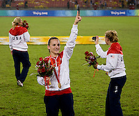 USWNT forward Amy Rodriguez salutes the crowd after playing for the gold medal at Workers' Stadium.  The USWNT defeated Brazil, 1-0, during the 2008 Beijing Olympics women's soccer final in Beijing, China.