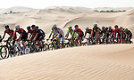 The peloton amidst the sand dunes of the Rub al Khali desert during Stage 1, The ADNOC Stage, of the 2015 Abu Dhabi Tour running 174 km from Qasr Al Sarab to Madinat Zayed, Abu Dhabi. 8th October 2015.<br /> Picture: ANSA/Claudio Peri | Newsfile