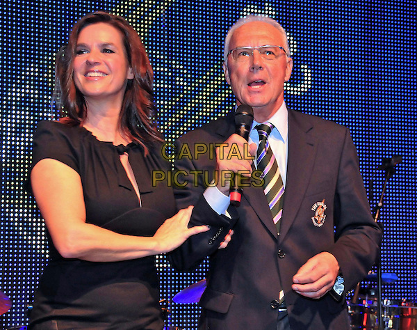 Katarina Witt  & Franz Beckenbauer.Hermes-Eagles Praesidenten Golf Cup, Abschluss-Gala, Robinson Club Quinta da Ria, Portugal..November 19th, 2011.dinner gala half length black dress suit glasses microphone .CAP/PPG/HW.©HW/People Picture/Capital Pictures