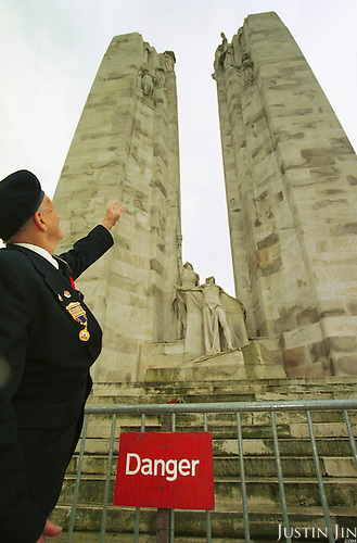 Canadian war veteran Regan Francis points at the arm of a statue that is in danger of falling off...Photo taken 10 May 2000 at the Canadian War Memorial at Vimy, France..Credit: Justin Jin