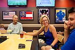 Kelsey Smith (middle) and her boyfriend Zach Sperry share drinks with Brad (wouldn't give last name) at Buffalo Wild Wings in Concourse D at Hartsfield–Jackson Atlanta International Airport, in Atlanta, Georgia on August 28, 2013.