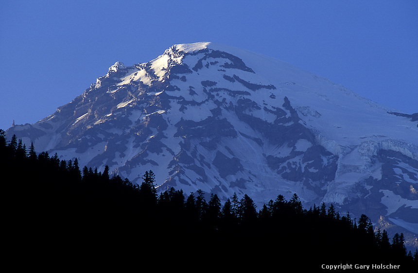 Mt Rainier in silhouette, Longmire. WA