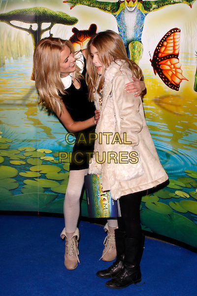 Donna Air & Freya.'Cirque Du Soleil: Totem' UK Premiere, Royal Albert Hall, London, England..5th January 2012.full length black sleeveless dress white tights grey gray boots leopard print mother mom mum daughter family side profile bending leaning .CAP/AH.©Adam Houghton/Capital Pictures.
