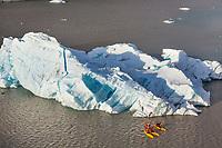 Tourists kayak by icebergs in Nellie Juan Lagoon, Prince William Sound, Chugach National Forest, Kenai Peninsula, southcentral, Alaska.