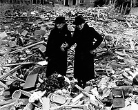Two bewildered old ladies stand amid the leveled ruins of the Almshouse which was Home; until Jerry dropped his bombs.  Total war knows no bounds.  Almshouse bombed Feb. 10, Newbury, Berks., England.  February 11, 1943.  Naccarata. (Army)<br /> Exact Date Shot Unknown<br /> NARA FILE #:  111-SC-178801<br /> WAR &amp; CONFLICT BOOK #:  1261