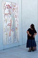 Woman looking at Mayan mural, Gran Museo del Mundo Maya museum in Merida, Yucatan, Mexico