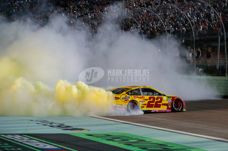 Nov 18, 2018; Homestead, FL, USA; NASCAR Cup Series driver Joey Logano (22) celebrates with a burnout after winning the Ford EcoBoost 400 and the NASCAR Cup Series championship at Homestead-Miami Speedway. Mandatory Credit: Mark J. Rebilas-USA TODAY Sports