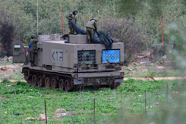 A picture taken on December 5, 2018 shows Israeli soldiers standing on atop of M270 Multiple Launch Rocket System near the northen Israeli kibbutz of Yiftah near the border with Lebanon. - Israel had announced on December 4 that it had discovered Hezbollah tunnels infiltrating its territory from Lebanon and launched an operation to destroy them. Photo by: Ayal Margolin-JINIPIX