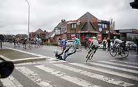 crash in the peloton; Andrea Del Col (ITA/Southeast) is one of the victims with Alan Marangoni (ITA/Cannondale-Garmin) justly avoiding him by skidding around (and managing to stay upright!)<br /> <br /> 70th Dwars Door Vlaanderen 2015