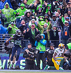 Seattle Seahawks cornerback Richard Sherman (25) celebrates after intercepting a pass in the end zone while defending against Green Bay Packers wide receiver Devante Adams (17) during the NFC Championship game at CenturyLink Field in Seattle, Washington on January 18, 2015.  The Seattle Seahawks beat the Green Bay Packers in overtime 28-22 for the NFC Championship Seattle.  ©2015. Photo by Jim Bryant, All Rights Reserved.