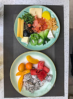 Nanjing, Jiangsu, China.  Breakfast Plates:  dragon fruit, Fruit Dish, Kumquats, Peaches, watermelon, cheese, smoked salmon, seaweed, mushrooms.