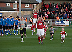 Fleetwood Town 1 Wrexham 1, 10/04/2012. Highbury Stadium, Football Conference Premier. Home team captain Steve McNulty applauded his supporters before Fleetwood Town (in red) hosted Wrexham in a Blue Square Conference Premier match at Highbury Stadium. The match, between the top two teams in the division ended in a 1-1 draw watched by a near-capacity crowd of 4996. A victory for the hosts would have seen the club promoted to the Football League for the first time. Photo by Colin McPherson.