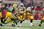 Pittsburgh Steelers running back Isaac Redman (33) breaks the tackle of Green Bay Packers linebacker Mat Wilhelm (57) and defensive back Pat Lee (22) during Super Bowl XLV on Sunday, February 6, 2011, in Arlington, Texas. The Packers won 31-25. (AP Photo/David Stluka)