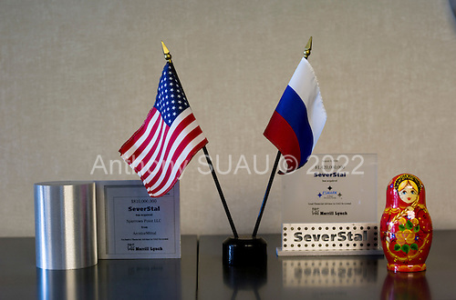 Dearborn, Michigan<br /> USA<br /> February 16, 2011<br /> <br /> An American and Russian flag at the entrance to the office of Severstal North America CEO, Sergei Kuznetsov is about the only visual symbol of Russian ownership of the company in the entire plant.<br /> <br /> The former Ford Rouge Steel Plant completed in 1928 is now owned, run and being renovated and expanded by Russian owner &quot;Severstal North America&quot;. This is one of five steel plants owned by Severstal in the United States and they are spending huge sums to convert it into what could be the continent's most efficient automotive steel plant.<br /> <br /> Rouge Steel fell on hard times after Ford Motor Company spun it off in 1989 into an independent steel company. <br /> <br /> After buying the assets of the bankrupt company for USD 280 million, Severstal spent USD 350 million to repair one of the blast furnaces. The company built a new cold-rolling line which converts steel slabs into sheet metal. And it added a galvanizing line which coats sheet metal with zinc for rust-resistant body panels.<br /> <br /> The operation assets and improvements amount to USD 1.4 billion. Add in spending on a new mini mill in Columbus, Mississippi a USD 1.6 billion operation and Severstal has placed a USD 3 billion bet on North America auto industry.