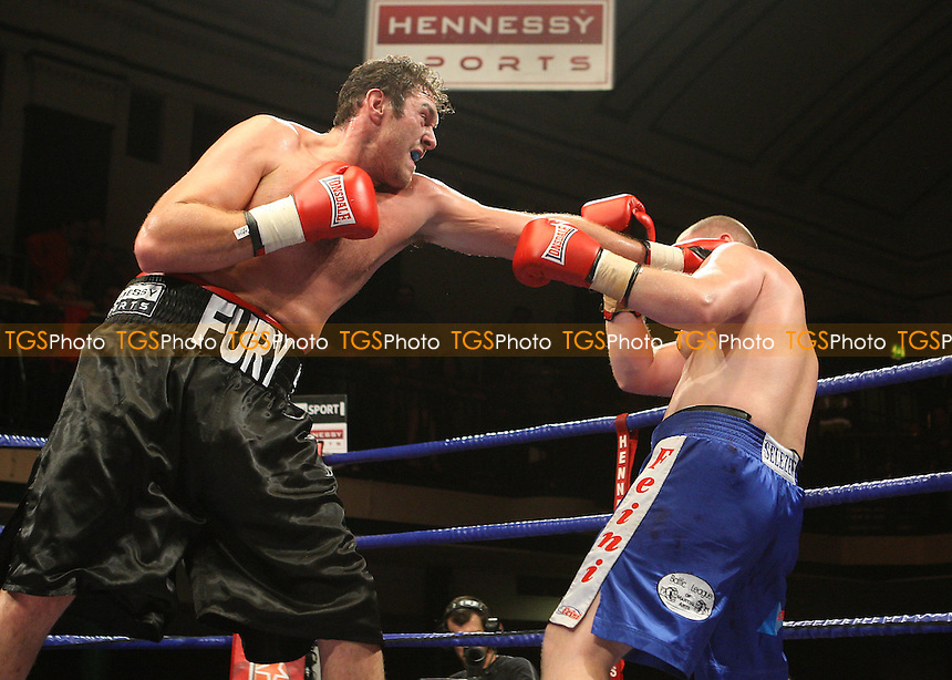 Tyson Fury (Manchester, black shorts) defeats Aleksandrs Selezens (blue shorts) in a Heavyweight Boxing contest at York Hall, Bethnal Green, promoted by Hennessy Sports - 18/07/09 - MANDATORY CREDIT: Gavin Ellis/TGSPHOTO - Self billing applies where appropriate - Tel: 0845 094 6026