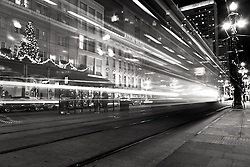 A streetcar rides past the Astor Hotel at Christmas.