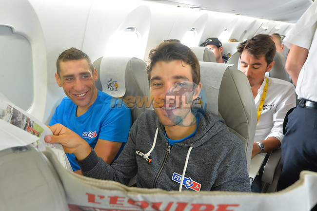 Thibaut PINOT (FRA) FDJ catches up with the latest news on board the plane to take the teams to the start of Stage 21 of the 2015 Tour de France running 109.5km from Sevres to Paris - Champs Elysees, France. 26th July 2015.<br /> Photo: ASO/B.Bade/Newsfile