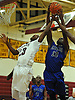 Andre Morgan #13 of Copiague, right, and Korey Lee #23 of Whitman go up for a rebound during a Suffolk County varsity boys' basketball game at Whitman High School on Tuesday, Dec. 15, 2015. Morgan scored 16 points in Copiague's 54-34 win.