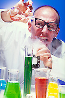 Mad Scientist mixing up potions in his laboratory. colorful liquids, containers, beakers. Mike McGrath. Boulder Colorado.